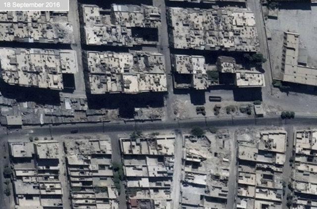 Halep'te iki haftada gerçekleşen yıkımın fotoğrafları 1