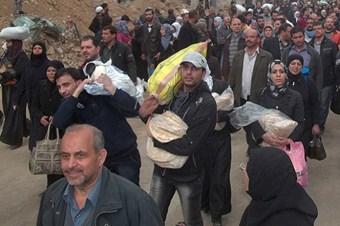 Yermuk'ta 500 koli yardım dağıtıldı