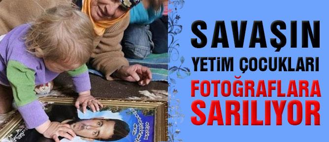 Savaşın yetim çocukları fotoğraflara sarılıyor