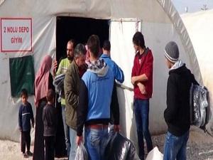 Akçakale'de Suriyeliler'e kaban dağıtıldı