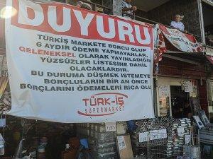 Kabaran veresiye defteri market sahibine 'afiş' astırttı