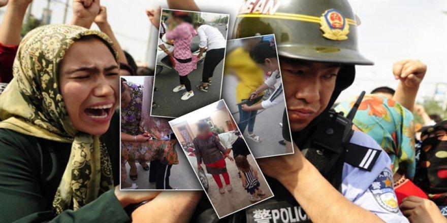 Çin polisi, Uygurlu Müslüman kadınların elbiselerini kesiyor, kısaltıyor!