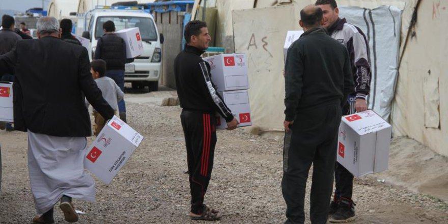Türk Kızılayı'ndan Telaferli iç göçmenlere kışlık giysi yardımı