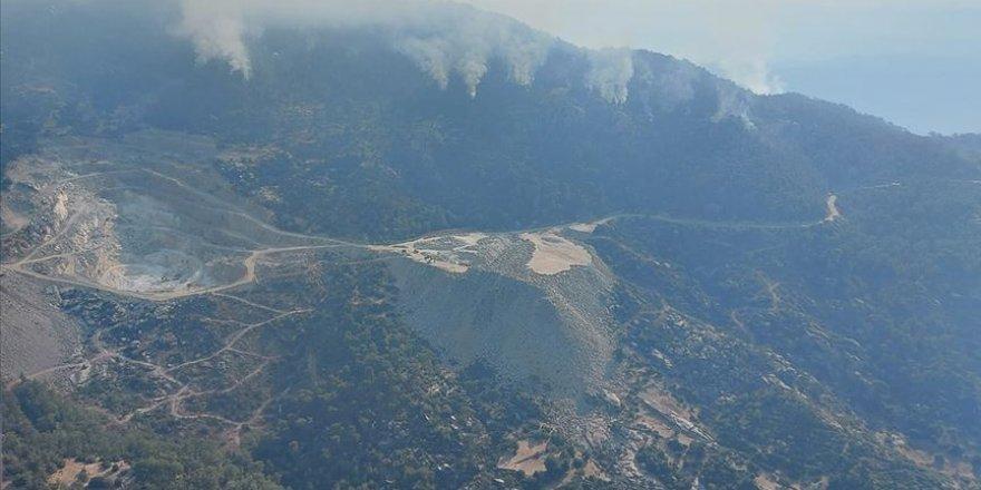 Aydın'da çıkıp Muğla'ya kadar uzanan orman yangını kontrol altına alındı