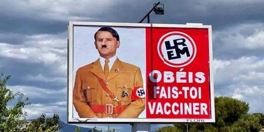 Macron, Hitler'e benzetildiği afişlerle ilgili suç duyurusunda bulundu